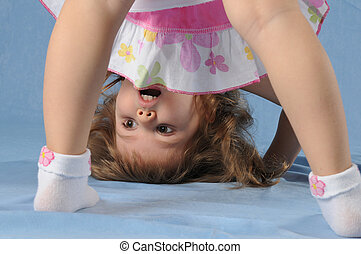Cute little girl upside down