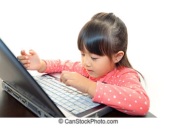Cute little girl using a laptop