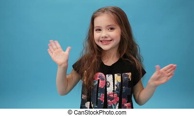 cute little girl waves her hands - young girl waves her...