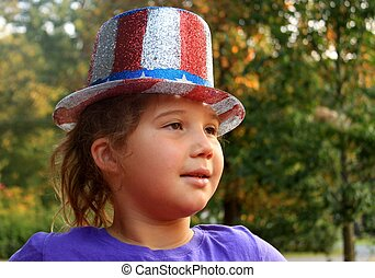 Cute little girl wearing 4th of July top hat