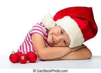 Cute little girl wearing santa hat - Cute little girl is ...