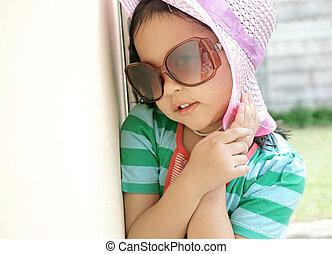 Cute little girl wearing sun glasses