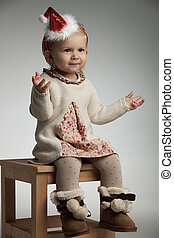 cute little girl welcoming santa claus