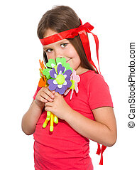 Cute little girl wit a bunch of flowers