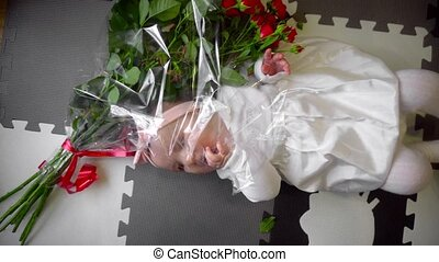 Cute little girl with a bouquet of roses