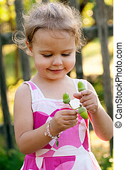 Cute little girl with acorns