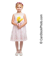 Cute little girl with bouquet of yellow tulips - Little girl...