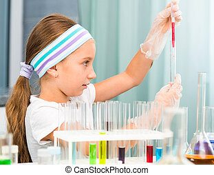 little girl with flasks for chemistry