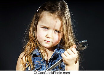 Cute little girl with gas spanner in her hands
