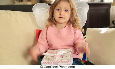 Cute little girl with gift box