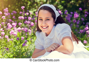 Little Girl with her First Communion Dress