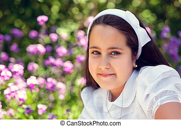 Cute Little Girl with her First Communion Dress