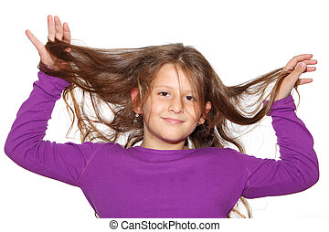 Cute little girl with long hair on a white background