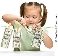 Cute little girl with paper money - dollars - Cute little...
