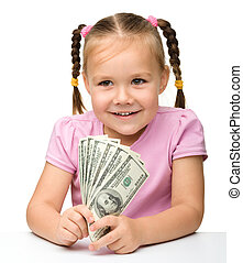 Cute little girl with paper money - dollars, isolated over...