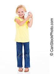 cute little girl with piggybank full length
