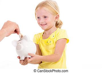 cute little girl with piggybank
