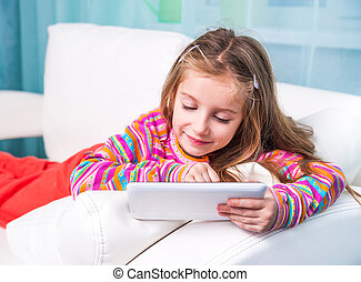 cute little girl with the tablet
