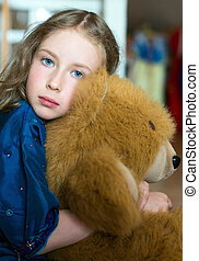 Cute little girl with toy bear.