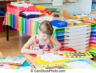 Cute little girl working in a classroom