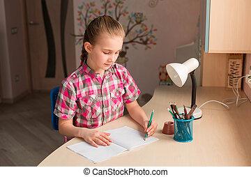 Cute little girl writing her homework