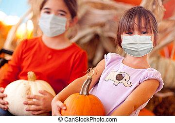 Cute Little Girls Holding Their Pumpkins At A Pumpkin Patch Wearing Medical Face Masks