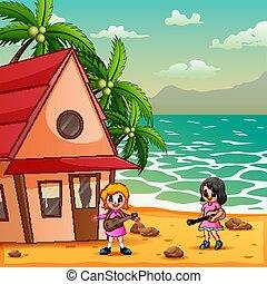 Cute little girls playing guitar on the beachside