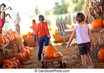 Cute Little Girls Pulling Their Pumpkins In A Wagon At A...