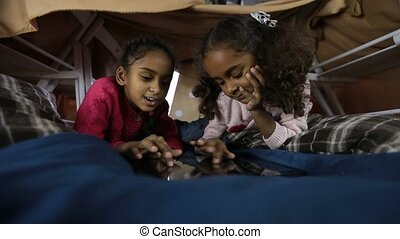 Cute little girls surfing the net on tablet - Positive...