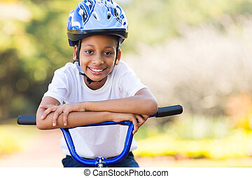 cute little indian girl on a bike