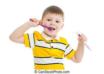 Cute little kid boy brushing teeth, isolated on white