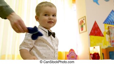 Cute little kid boy indoor - Baby boy is given a toy...