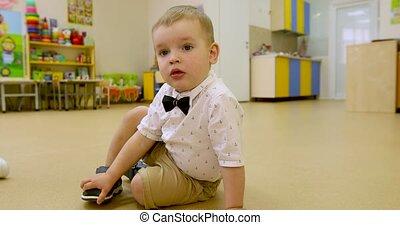 Cute little kid boy indoor - Portrait of baby boy sitting on...