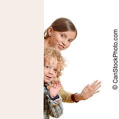 Cute little kids behind a white board