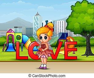Cute little love fairy in the park city