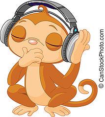 Cute little Monkey listening music with headphones