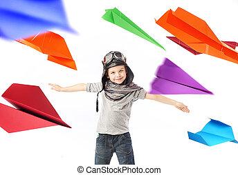 Cute little pilot among colorful paper planes - Cute little...