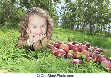 Cute little preschooler girl with apple