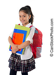 cute little school girl carrying schoolbag backpack and books smiling