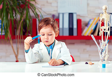 cute little scientist writing notes about experiments in lab