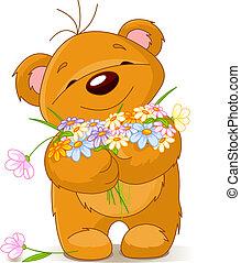 Cute little Teddy bear giving a bouquet