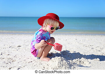 Cute Little Toddler Child Playing in the Sand on the Beach on a Summer Day