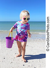 Cute Little Toddler Girl Playing on Beach by the Ocean