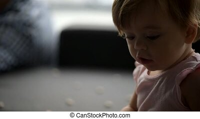 Cute little toddler playing at home