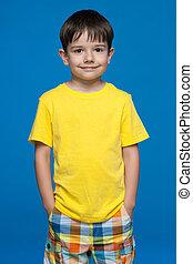 Cute little Ukrainian boy in yellow shirt