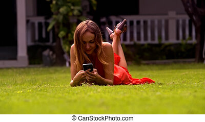 Cute Long Haired Girl Smiles Rests on Park Grass - closeup...