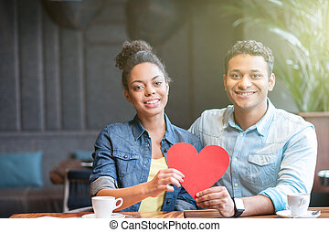 Cute loving couple is resting in restaurant
