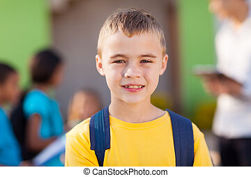 male elementary pupil - cute male elementary pupil outside...