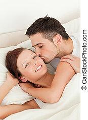 Cute Man kissing his wife on the cheek