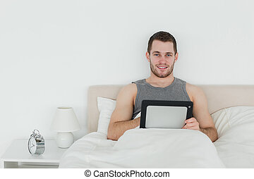 Cute man using a tablet computer
